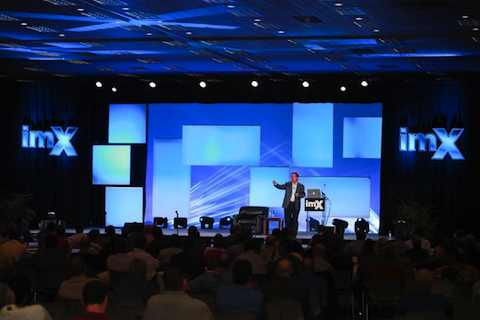 Jim Carroll on stage in September 2011, keynoting the IMXchange - Interactive Manufacturing Exchange -- conference, with a talk on the future of manufacturing and the necessity for continuous, relentless innovation